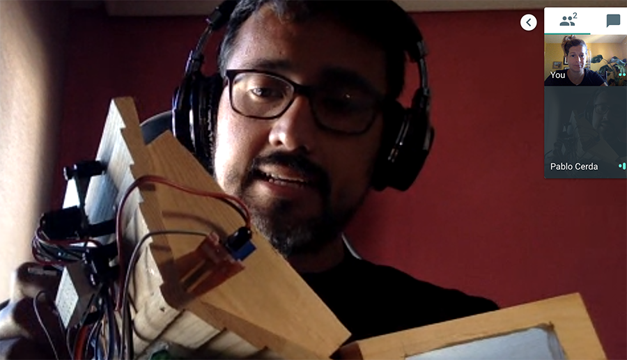 Pablo showing wooden turtle house on Google Hangout