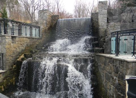 Waterfall between stone walls