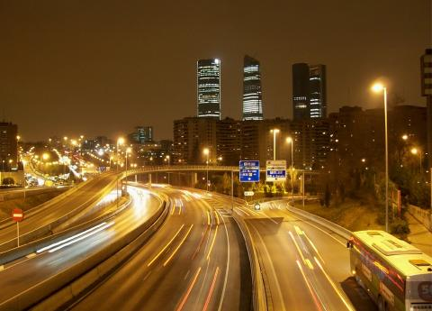 Nighttime in Madrid, with motion blur of cars on highway