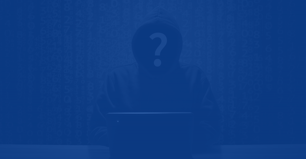 Anonymous hooded human sitting at a computer