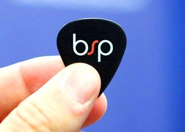Guitar pick with Bluespark logo